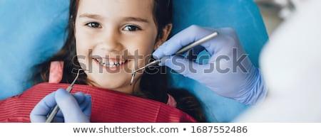 стоматолога · девушки · лечение · стоматологический · кабинет · служба · человека - Сток-фото © is2