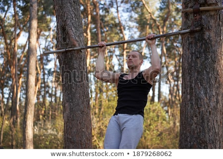 Young man muscular crossing arms in forest stock photo © FreeProd