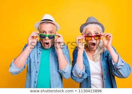 Senior couple woman touching man's face Stock photo © IS2