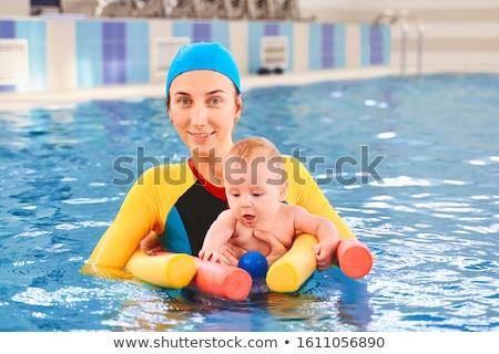 Portret grappig jonge vrouw zwempak poseren handen Stockfoto © deandrobot