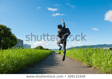 businessman jumping in the blue sky Stock photo © adrenalina