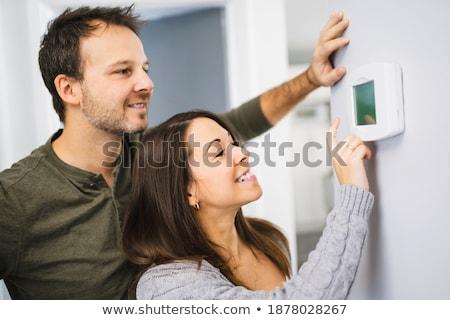 Paar ingesteld thermostaat home vrouw muur Stockfoto © Lopolo