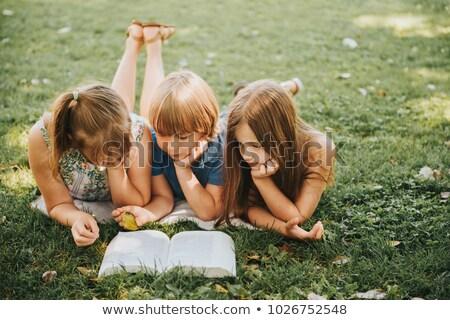 Dwa dziewcząt czytania podwórko ilustracja charakter Zdjęcia stock © colematt