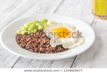 Porción rojo huevo frito apio mesa de madera alimentos Foto stock © Alex9500