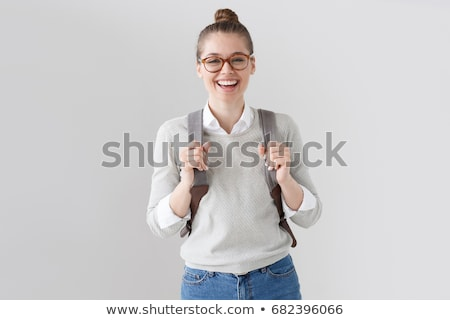 smiling young teenage girl with backpack stock photo © deandrobot
