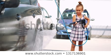 Little girl washing auto in self-serve car wash Stock photo © amok