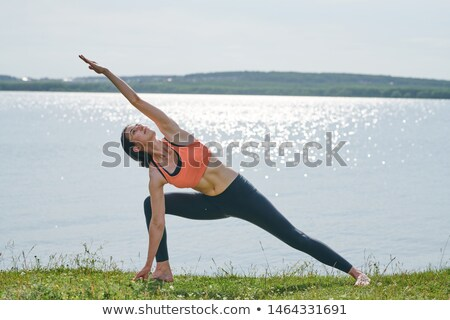 Content active young woman in sportswear standing on grass Stock photo © pressmaster