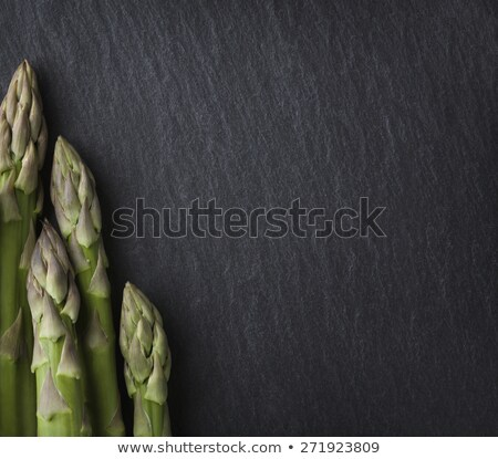 several asparagus framing stone copyspace stock photo © lichtmeister