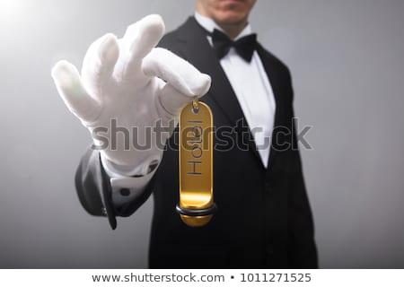 Mão hotel chave da porta cliente cinza Foto stock © AndreyPopov