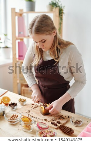 Creative girl cutting handmade soap bar with aromatic spices and orange slices Stock photo © pressmaster