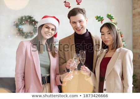 Szczęśliwy młodych kobieta interesu flet szampana patrząc Zdjęcia stock © pressmaster