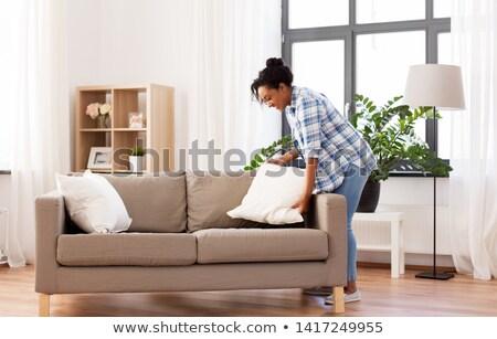 Afroamerikai nő kanapé párnák háztartás házimunka Stock fotó © dolgachov