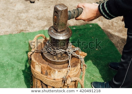 Ukrainian Cossack holding a large hammer Stock photo © ruslanshramko