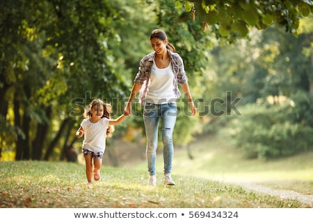 Little girl and mother in the park stock photo © Massonforstock