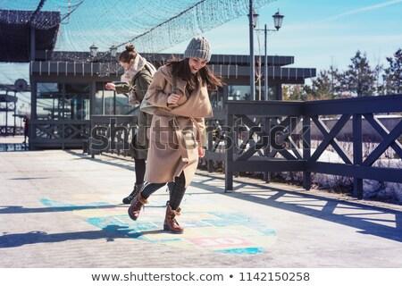 woman playing hopscotch stock photo © piedmontphoto
