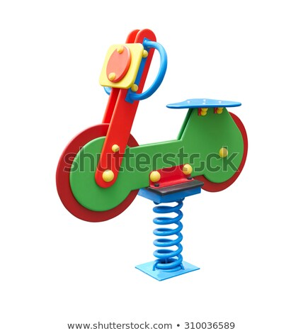 Stock photo: little girl with toy motorcycle and a toy