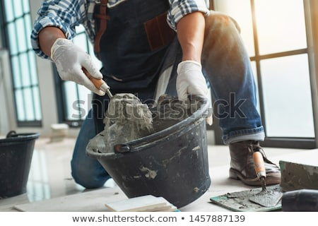 Mason with bucket and trowel Stock photo © photography33