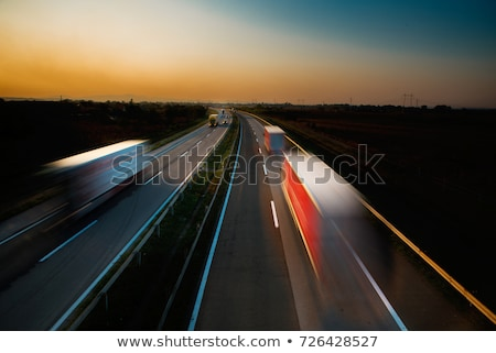 Stock photo: highway traffic - motion blurred truck on a highway/motorway