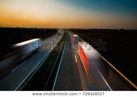 város · forgalom · mozgás · elmosódott · kép · autó - stock fotó © lightpoet