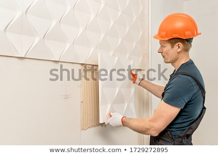 Man with white panel on wall Stock photo © photography33