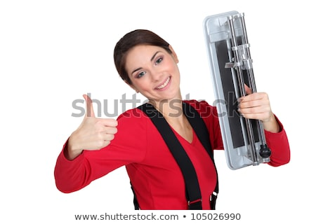 A female tiler giving the thumb up. Stock photo © photography33
