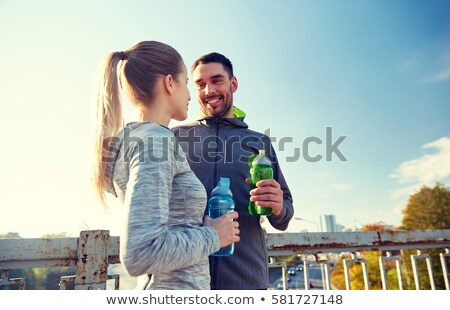 Energetic fit man holding water bottle Stock photo © stockyimages