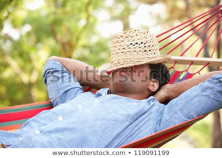 Man with hat on hammock Stock photo © photography33