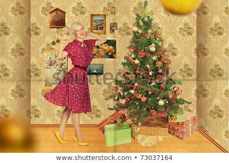 pin up in christmas on yellow stock photo © carlodapino