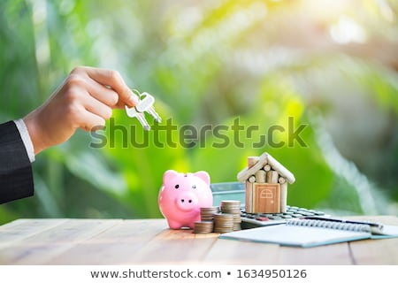 Customer returning contract to estate-agent Stock photo © photography33