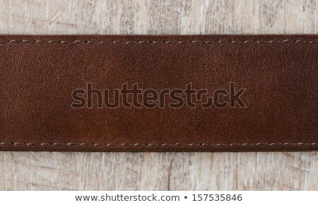 Leather belt on wooden background Stock photo © stevanovicigor