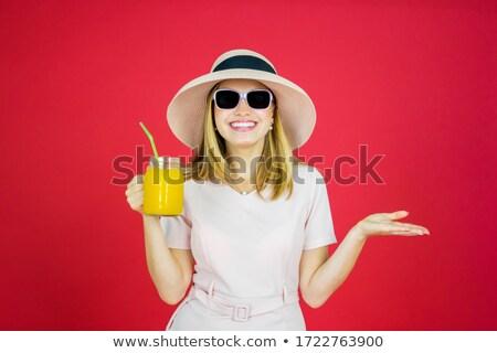 Mulher olhando câmera vermelho Foto stock © wavebreak_media