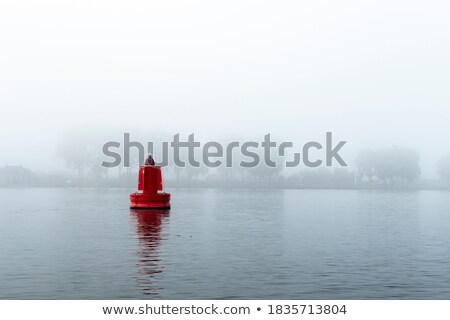 red buoy on river in mist Stock photo © Mikko