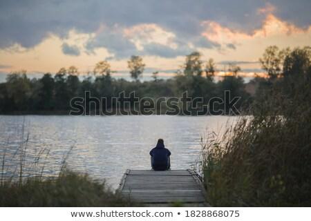 мальчика сидят пешеходный мост только мышления глядя Сток-фото © mikdam