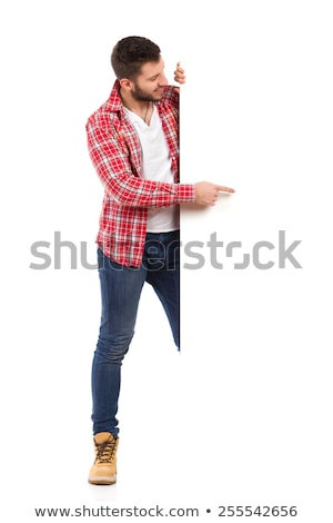 Young Man Standing Behind The Placard Stock photo © AndreyPopov