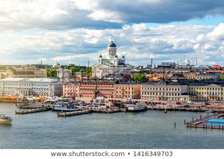 Finnország kéz tart pici zászló kék Stock fotó © Stocksnapper