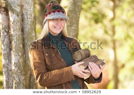 Woman Outdoors In Autumn Woodland Gathering Logs Stock photo © monkey_business