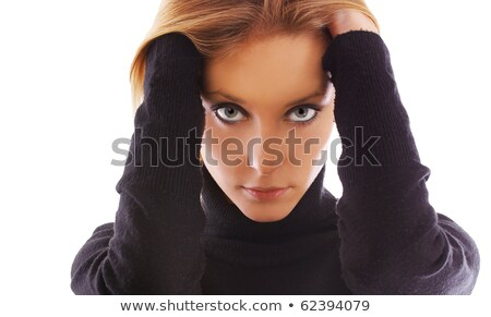 Young woman in warm clothing with hand over mouth Stock photo © bmonteny