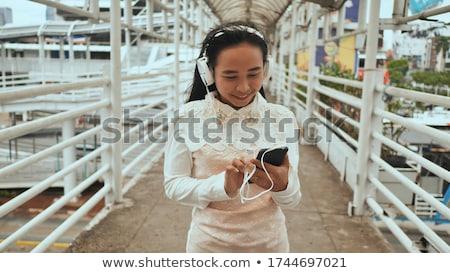 Beautiful woman enjoying her music library Stock photo © dash