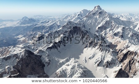 snow covered mountain peaks in the alps stock photo © chrisga