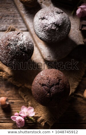 Fresh homemade muffins on wooden table Stock photo © dariazu