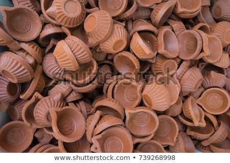 Pile of clay diya (lights) in market Stock photo © ziprashantzi