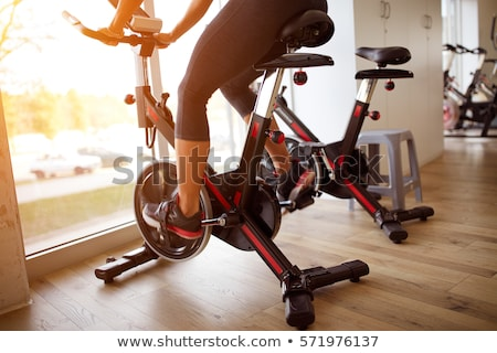 Stationary bike at the gym Stock photo © shutswis