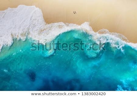 ondas · praia · mar · paisagem · pôr · do · sol · céu - foto stock © vapi