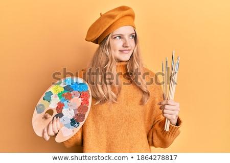 Femme souriante peintre pinceau pense table Photo stock © deandrobot