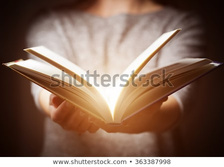 book in womans hands in gesture of giving stock photo © photocreo
