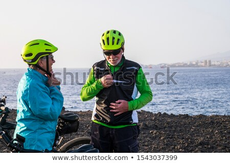 two bicyclists doing sport with their bikes stock photo © kzenon