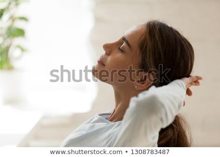 çekici genç kadın gözleri kapalı baş ağrısı siyah Stok fotoğraf © deandrobot