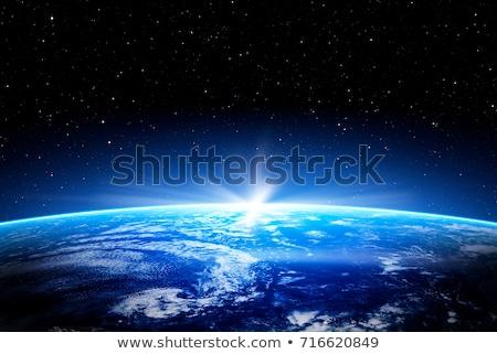 Ziemi niebieski planety Ziemi spektakularny wygaśnięcia słońce Zdjęcia stock © solarseven
