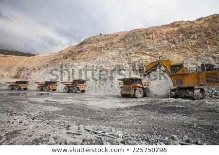 Dump trucks lined up at a rock quarry Stock photo © njnightsky
