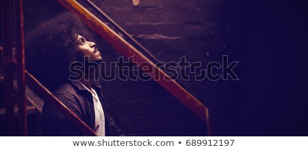 thoughtful man sitting on steps at nightclub stock photo © wavebreak_media